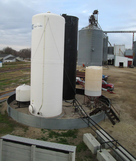 Sioux Steel style outdoor containment with bulk liquid fertilizer tanks.