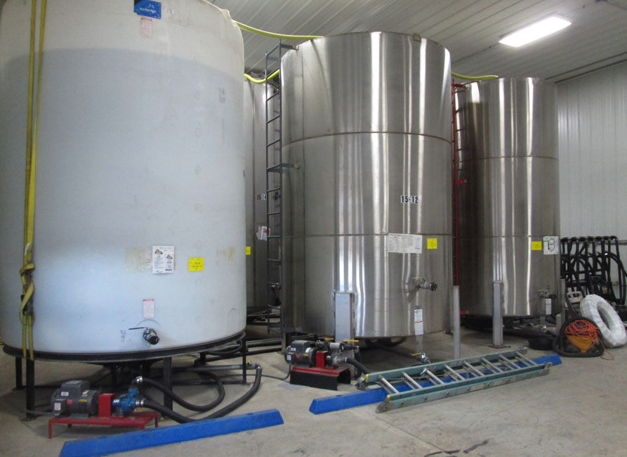 photo shows bulk liquid pesticide tanks stored at a pesticide facility.