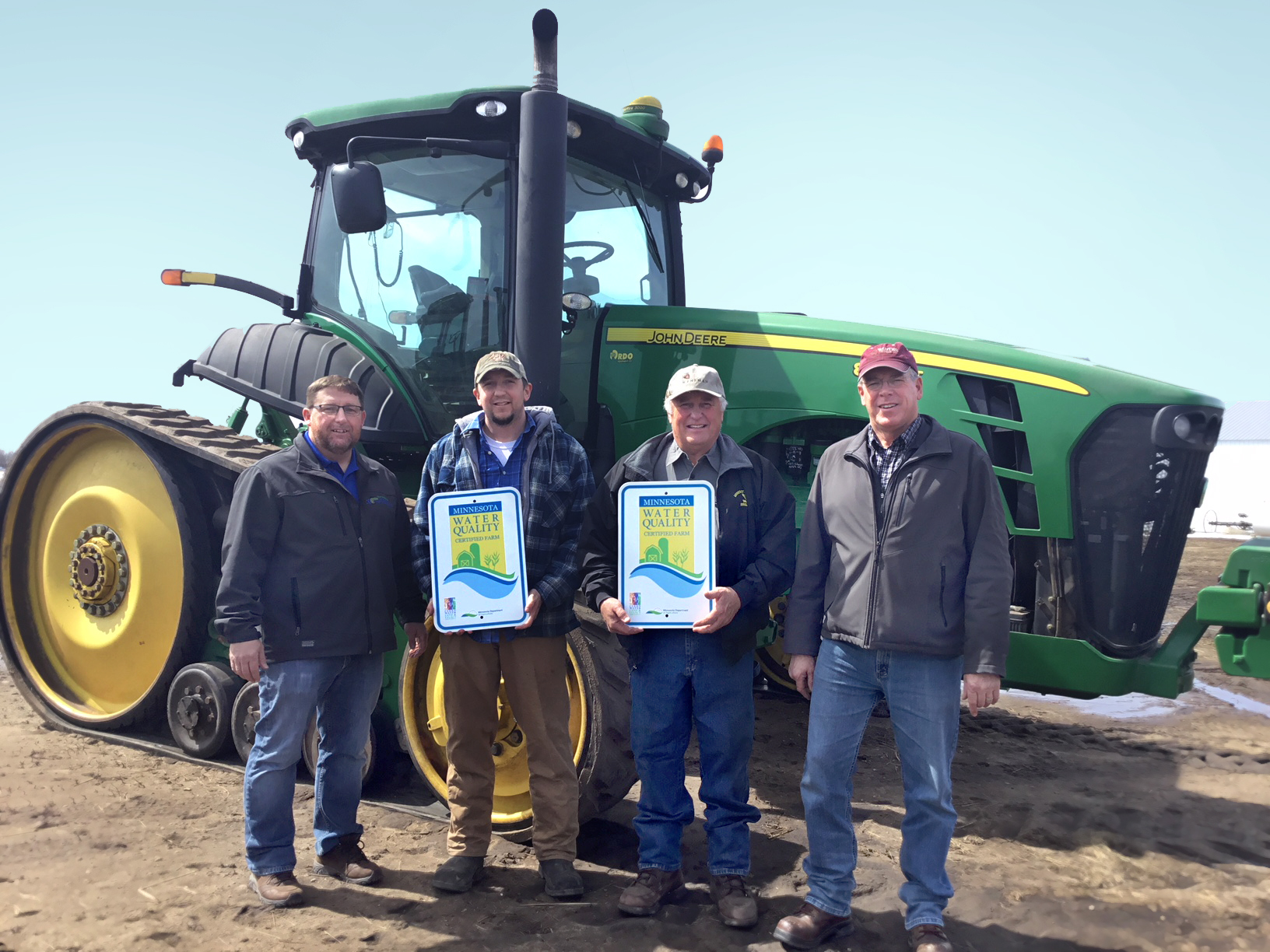 Darren Newville, District Manager at East Otter Tail and Wadena Soil and Water Conservation Districts; MAWQCP certified producers Andrew and Dale Schock; MAWQCP Area Certification Specialist Jim Lahn.