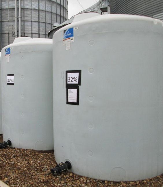 9c015f10e9fcc Photo shows on farm storage of two poly fertilizer tanks.