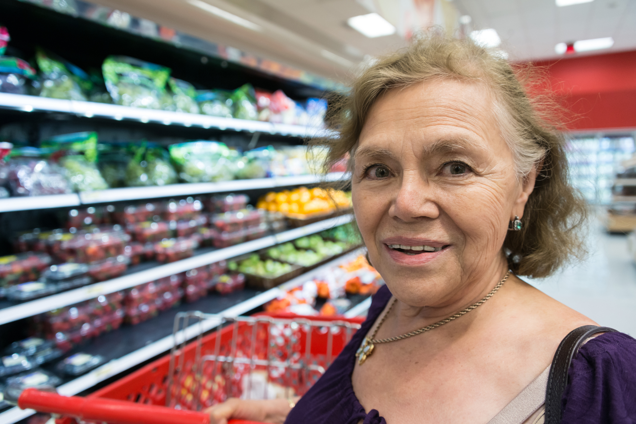 Senior woman buying groceries