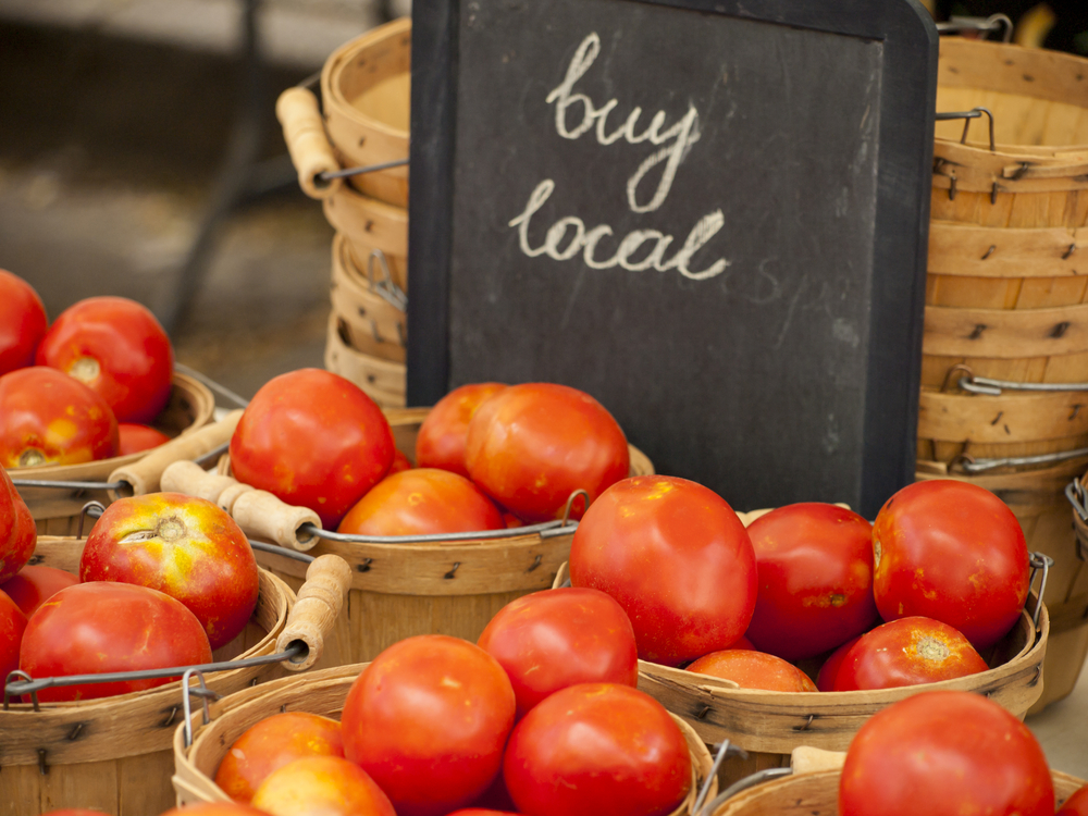 "tomatoes with a ""Buy Local"" sign"