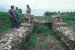 Gabions are wire baskets filled with large stones that are used to stabilize shores and prevent erosion. Photo courtesy of the USDA NRCS